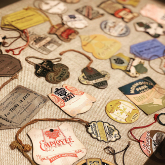 Assortment of late 19th century badges and entry tickets