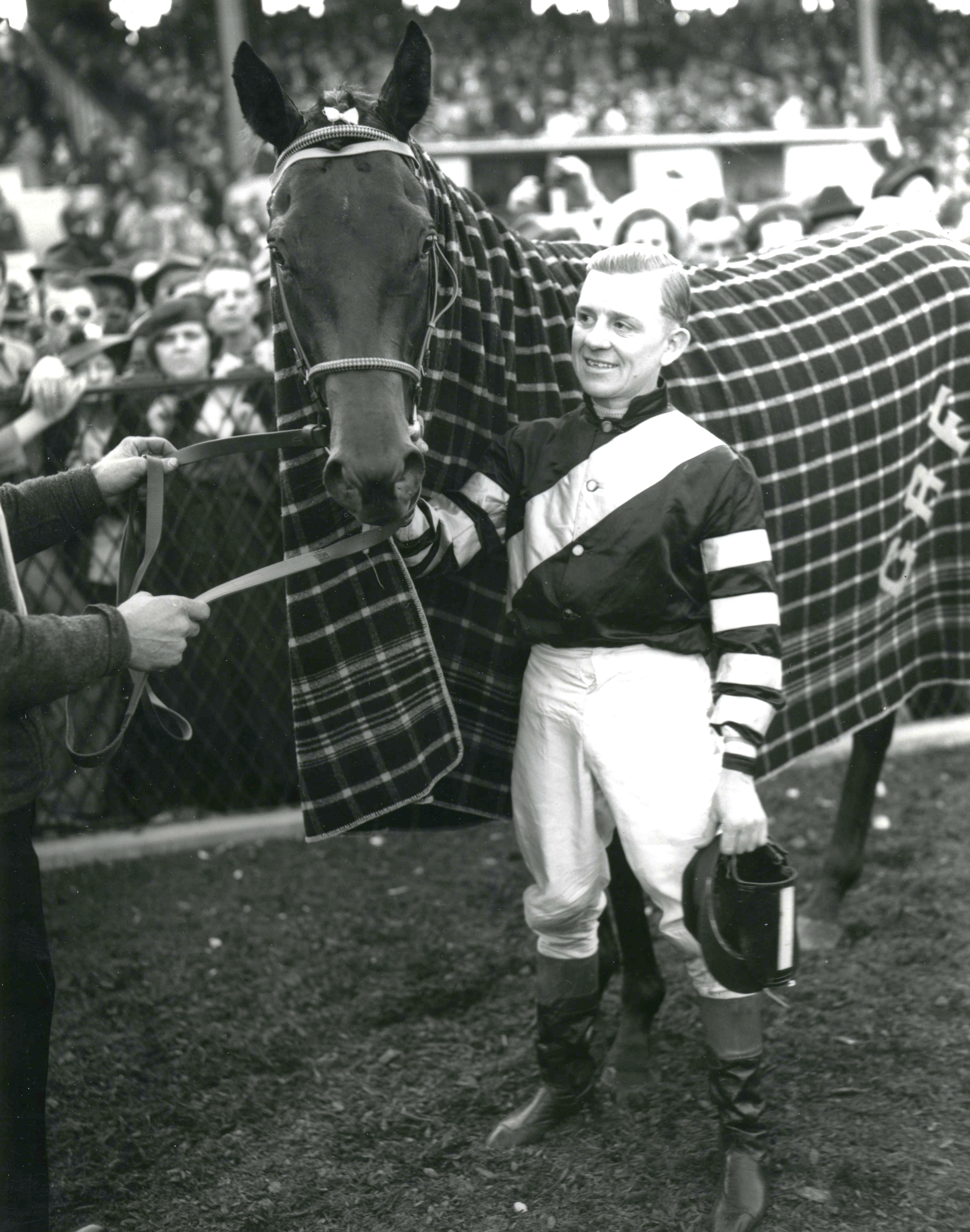 War Admiral with jockey Charles Kurtsinger after winning the 1937 Preakness at Pimilico (Keeneland Library Morgan Collection/Museum Collection)