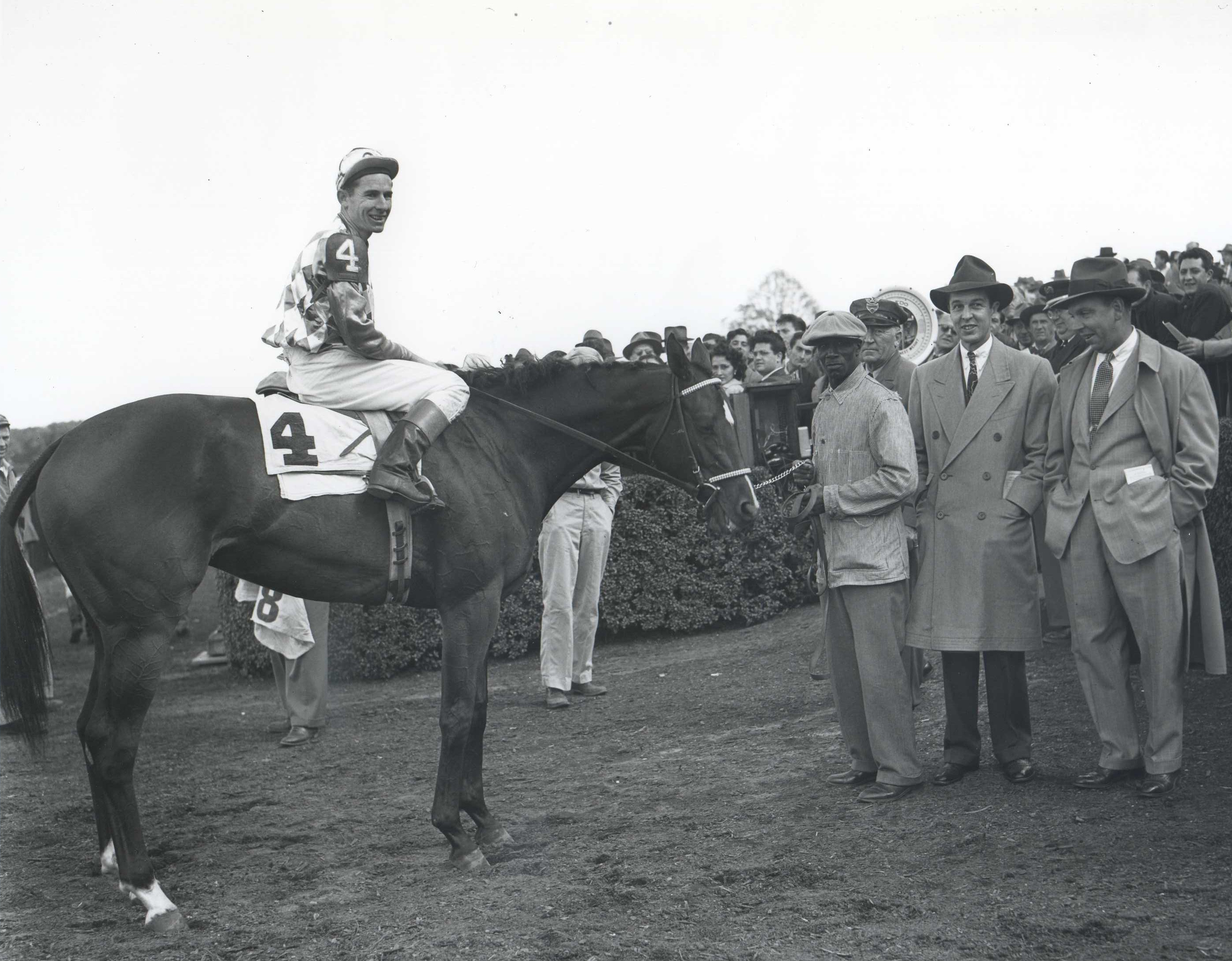 Bed o' Roses (Eric Guerin up) in the winner's circle for the 1949 Matron at Belmont Park (Keeneland Library Morgan Collection/Museum Collection)