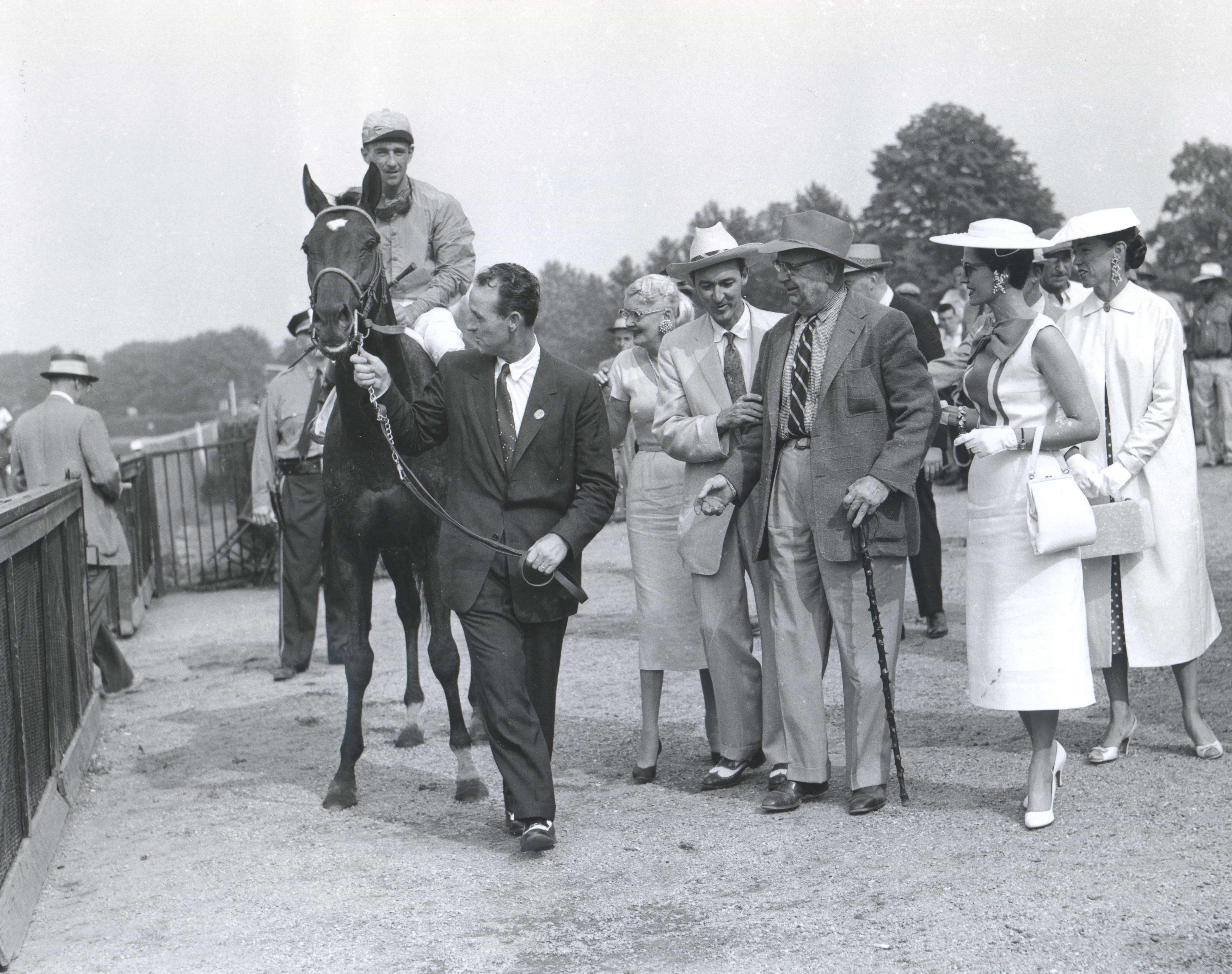 Needles (Dave Erb up) on his way to the winner's circle after winning the 1956 Belmont Stakes (Keeneland Library Morgan Collection/Museum Collection)
