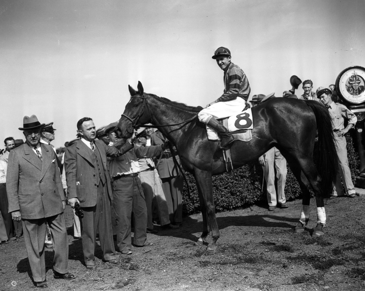 Armed (Doug Dodson up) in the winner's circle for the 1946 Suburban Handicap at Belmont Park (Keeneland Library Morgan Collection/Museum Collection)