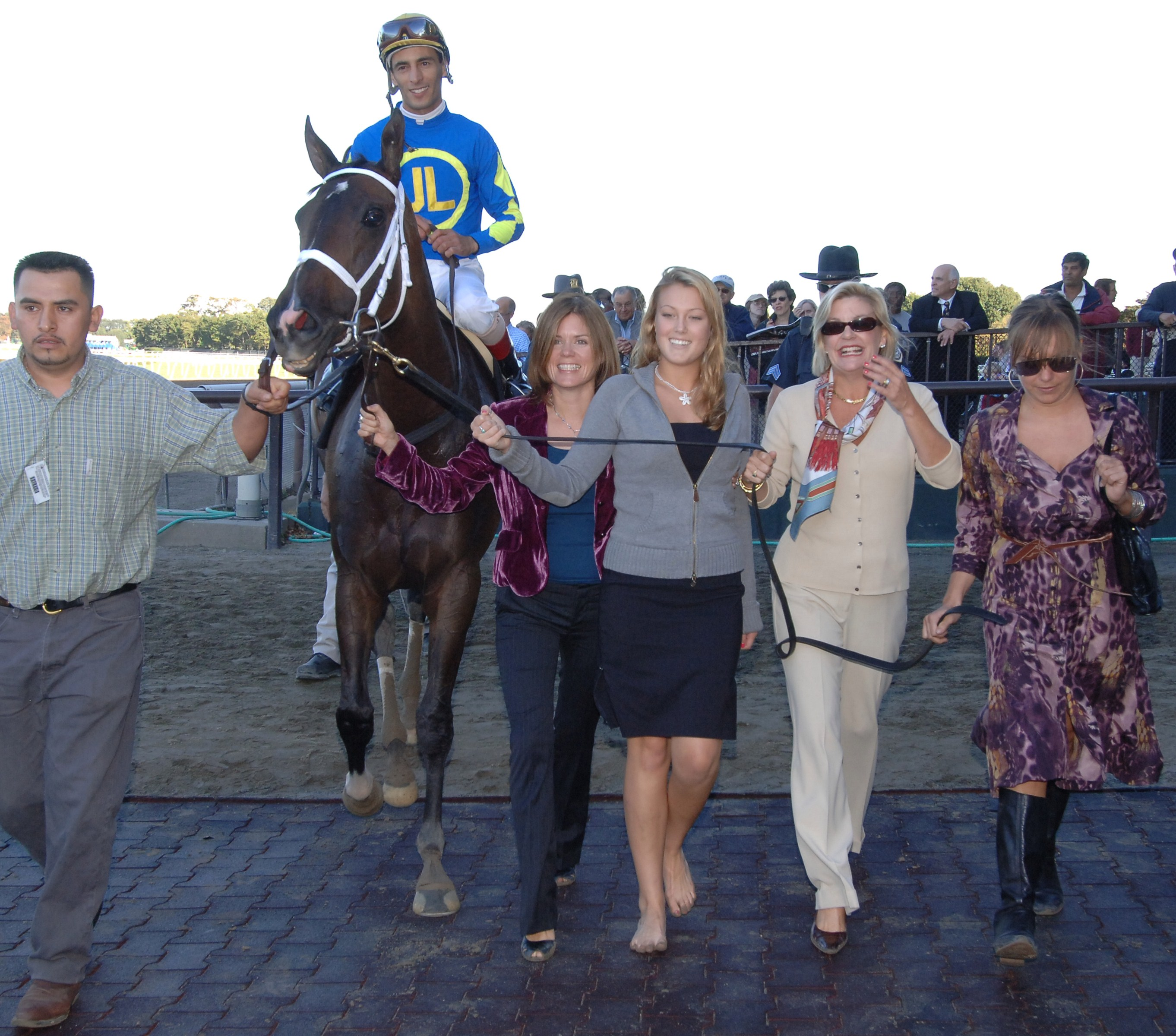 Ashado being led to the winner's circle after winning the 2005 Beldame at Belmont Park (NYRA)