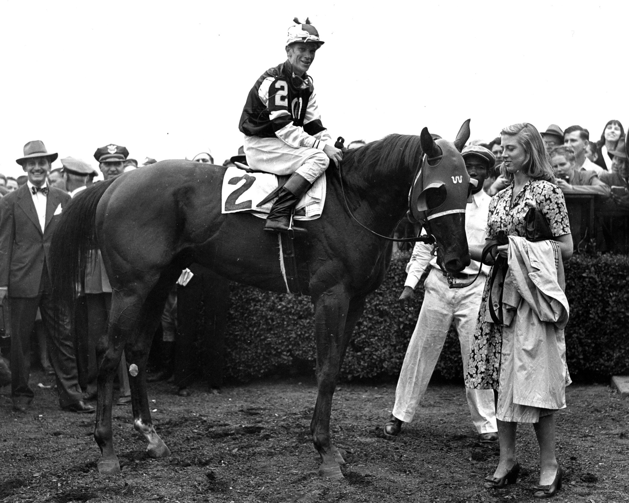 Assault in the 1946 Belmont Stakes winner's circle after winning the Triple Crown (Museum Collection)