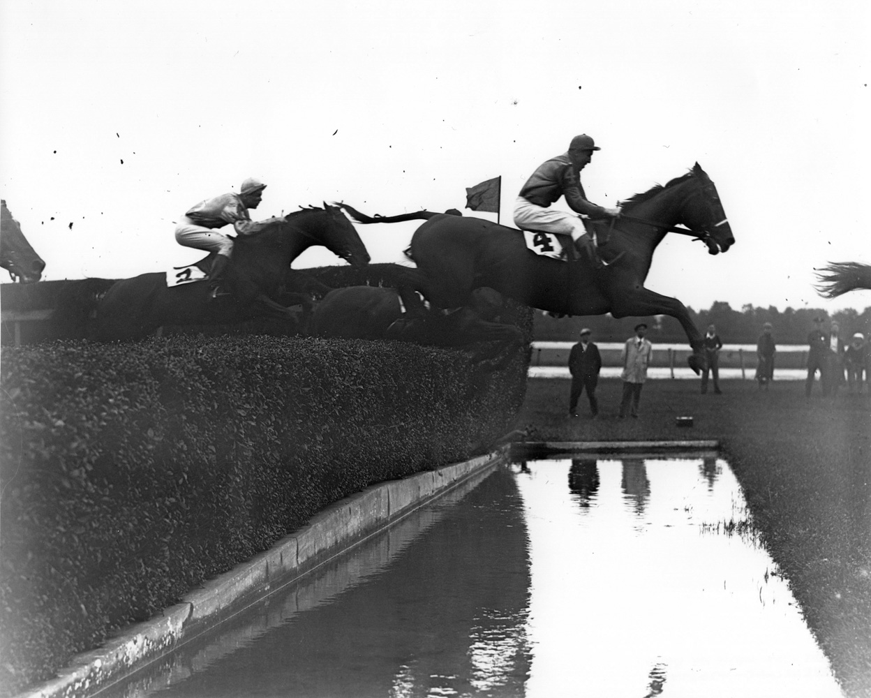 Battleship (Carroll K. Bassett up) clearing a water jump in the American Grand National Steeplechase at Belmont Park (Keeneland Library Morgan Collection/Museum Collection)