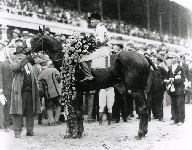 Black Gold (Jimmy Mooney up) in the winner's circle for the 1924 Kentucky Derby (Churchill Downs Inc./Kinetic Corp. /Museum Collection)