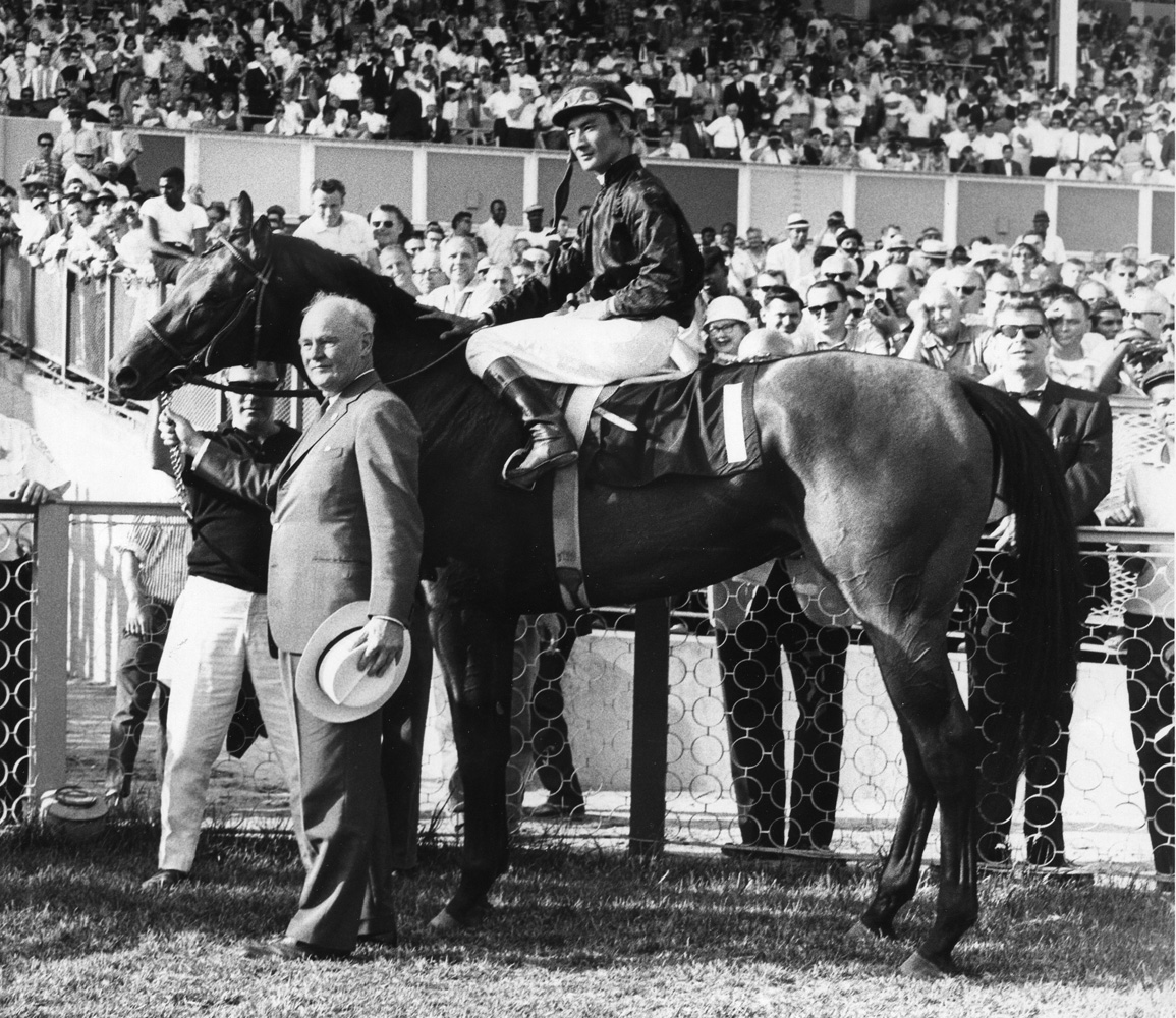 Buckpasser (Braulio Baeza up) in the winner's circle with owner Ogden Phipps for the 1966 Arlington Classic at Arlington Park (Museum Collection)