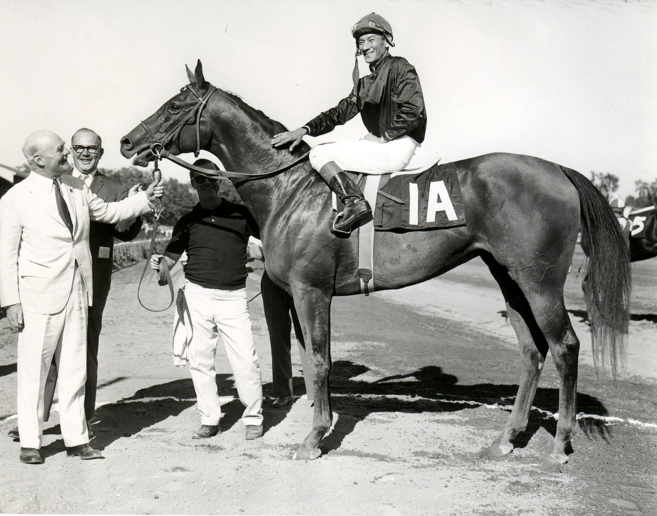 Buckpasser (Braulio Baeza up) in the winner's circle for the 1966 Travers Stakes at Saratoga (NYRA/Museum Collection)