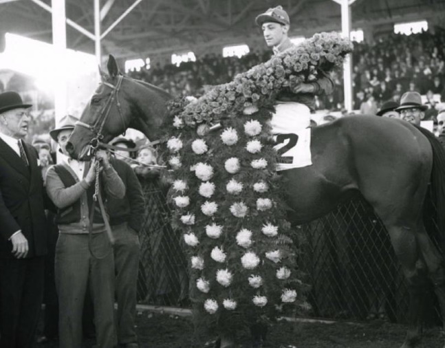 Challedon (Eddie Arcaro up) in the winner's circle for the 1939 Pimlico Special (Keeneland Library Morgan Collection/Museum Collection)
