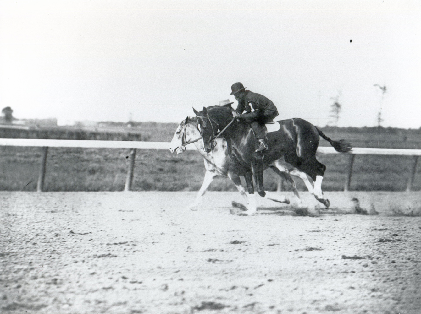 Colin warming up on the track with Marshall Lilly up (Keeneland Library Cook Collection/Museum Collection)
