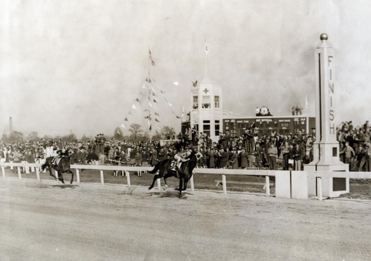 Count Fleet (Johnny Longden up) winning the 1943 Kentucky Derby (Museum Collection)