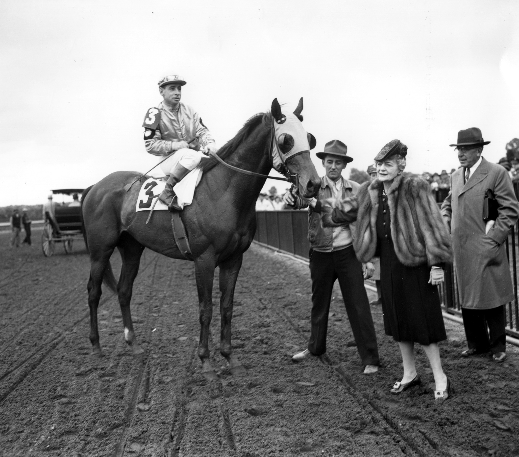 Count Fleet (Johnny Longden up) with owner Fannie Hertz in the winner's circle for the 1943 Withers at Belmont Park (Keeneland Library Morgan Collection/Museum Collection)