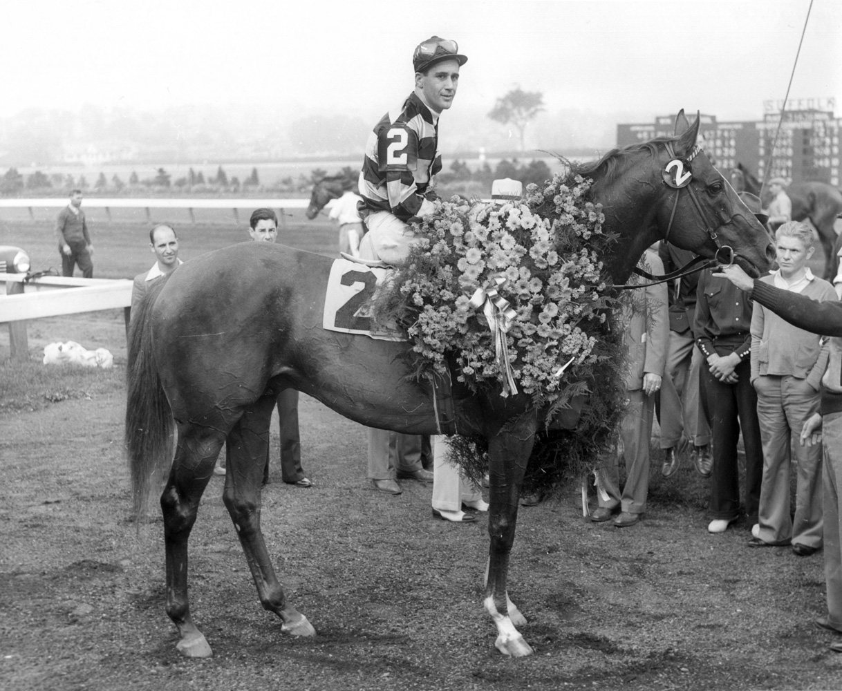 Eight Thirty (Harry Richards up) in the winner's circle for the 1940 Massachusetts Handicap at Suffolk Downs (Museum Collection)