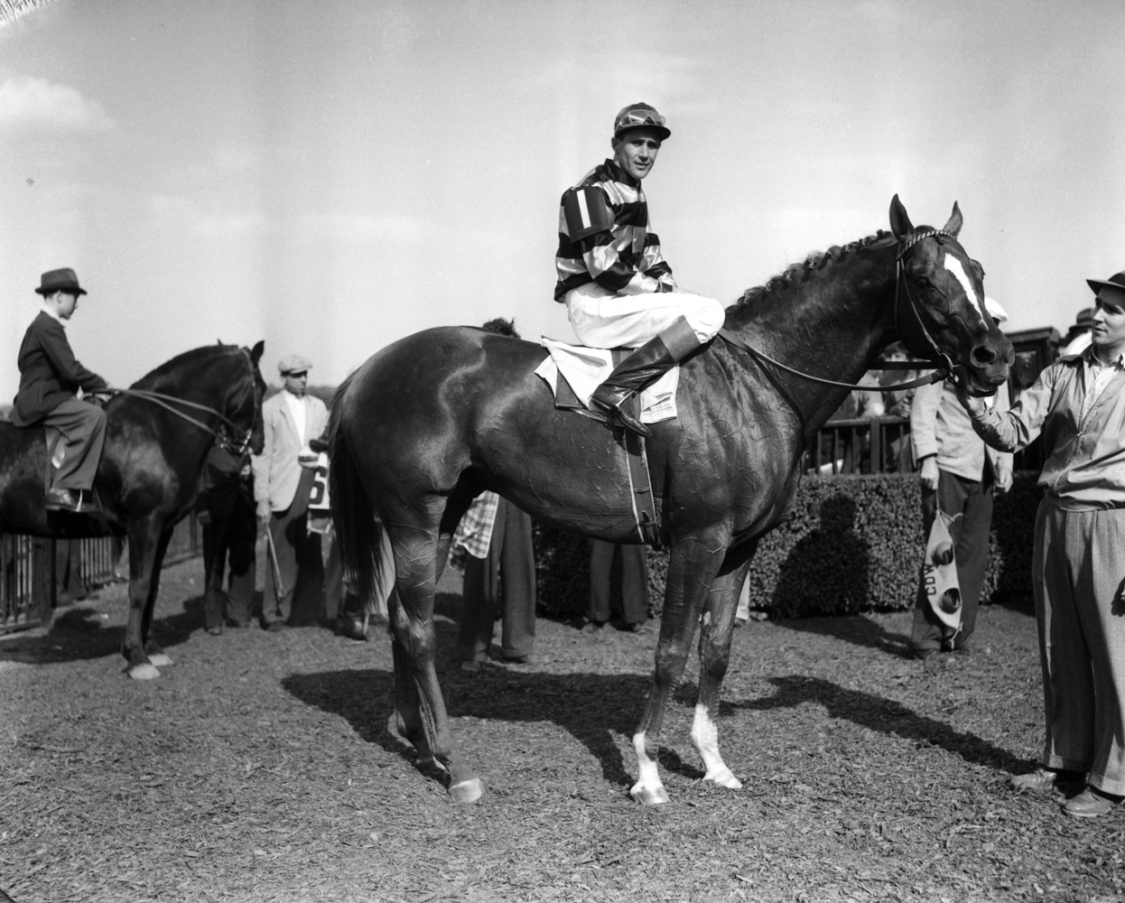 Eight Thirty (Harry Richards up) in the winner's circle for the 1941 Metropolitan Handicap at Belmont Park (Keeneland Library Morgan Collection/Museum Collection)