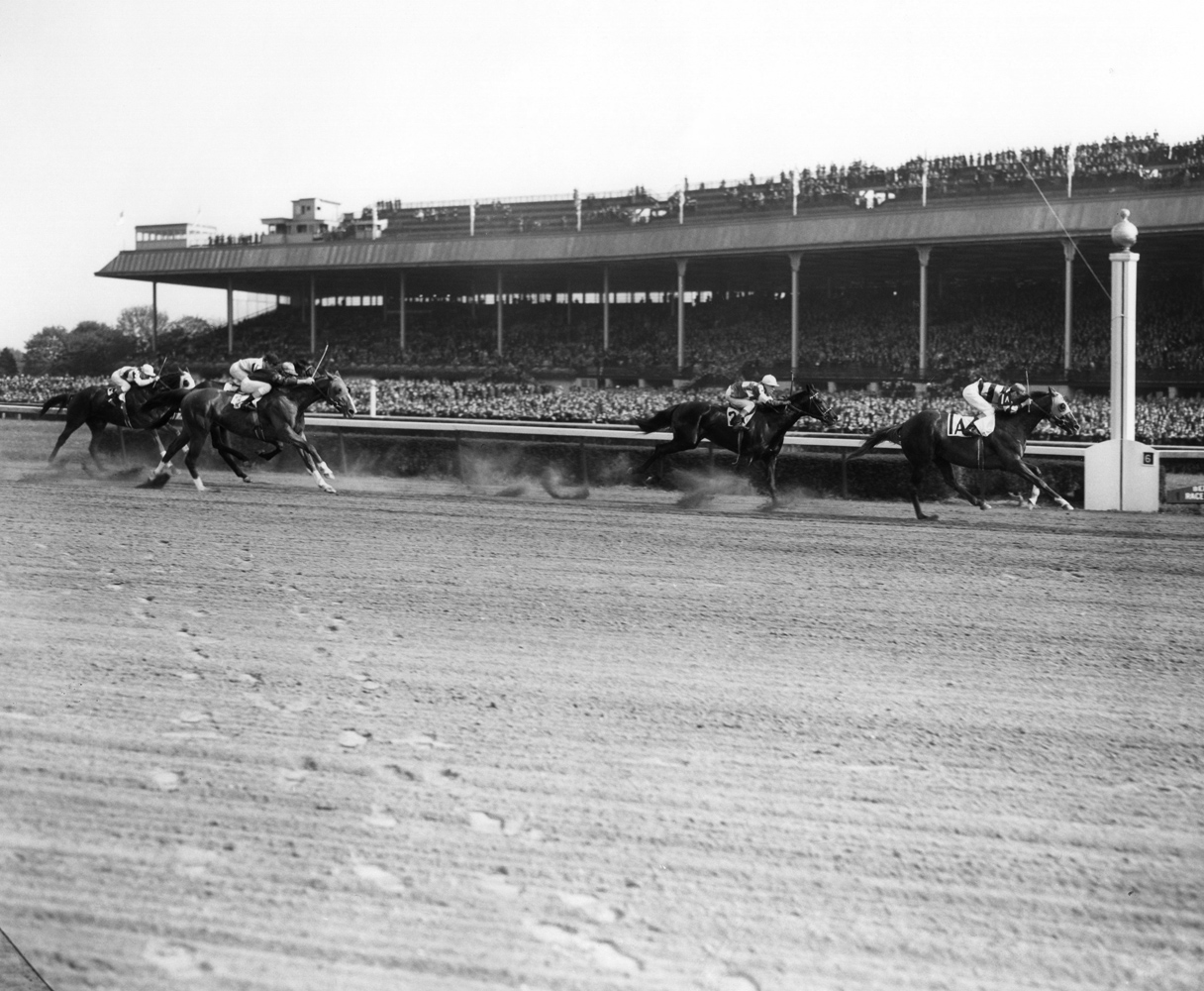 Eight Thirty (Harry Richards up) winning the 1940 Toboggan Handicap at Belmont Park (Keeneland Library Morgan Collection/Museum Collection)