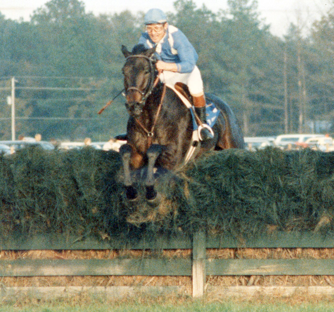 Flatterer (Jerry Fishback up) taking a jump in the Colonial Cup (Catherine French/Museum Collection)
