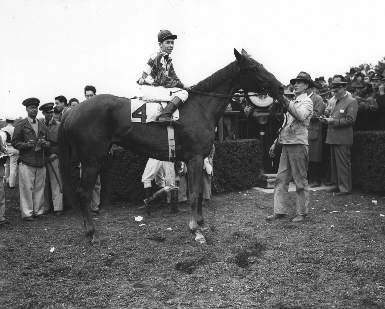 Gallorete with Job D. Jessop up in the winner's circle for the 1946 Metropolitan (Keeneland Library Morgan Collection/Museum Collection)
