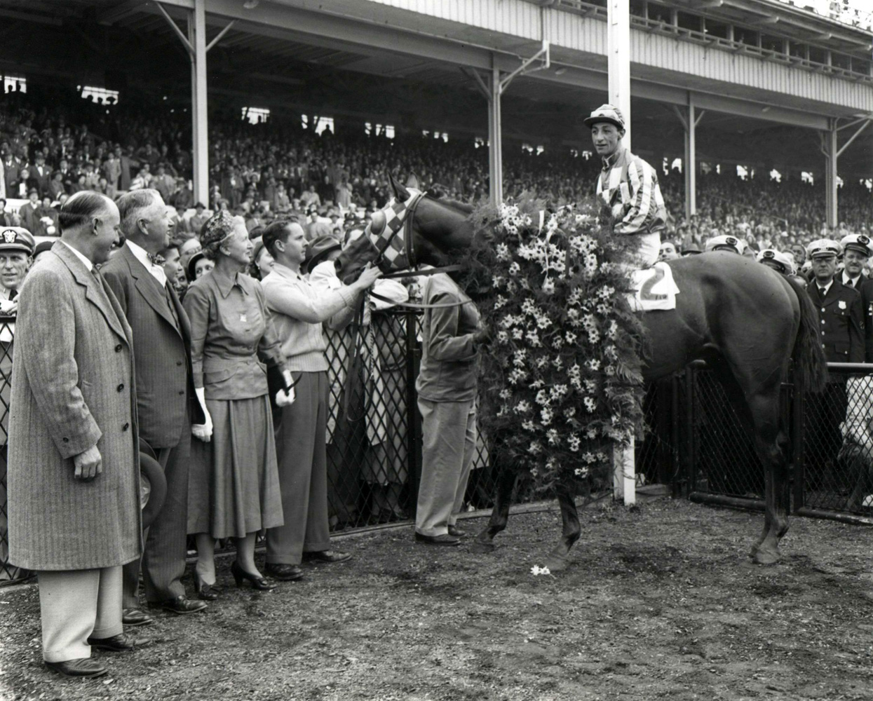 Hill Prince (Eddie Arcaro up) in the winner's circle for the 1950 Preakness at Pimlico Race Course (Keeneland Library Morgan Collection/Museum Collection)