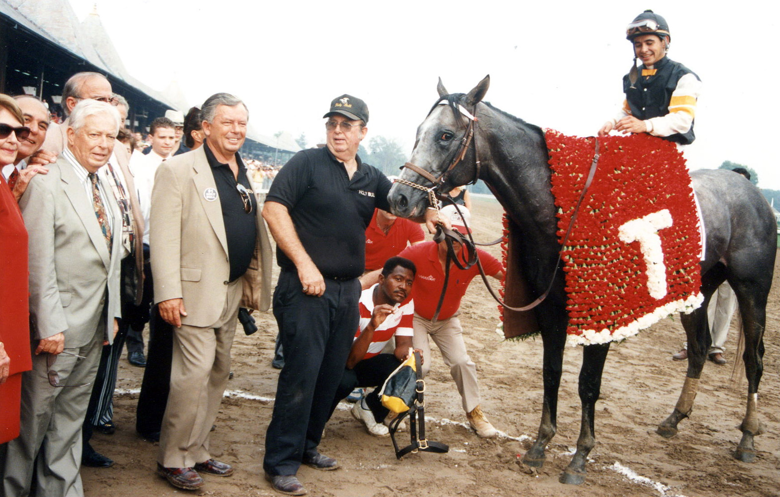 Holy Bull (Mike Smith up) in the winner's circle for the 1994 Travers Stakes (Barbara D. Livingston/Museum Collection)
