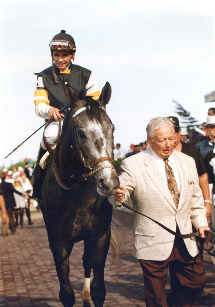 "Holy Bull (Mike Smith up) being led in by owner/trainer Warren A. ""Jimmy"" Croll, Jr. after winning the 1994 Metropolitan (Barbara Ann Giove Coletta/Museum Collection)"