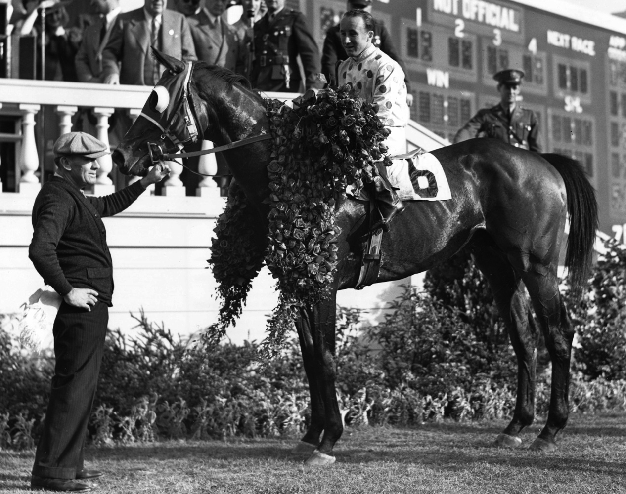 Johnstown (James Stout up) in the winner's circle for the 1939 Kentucky Derby (Churchill Downs Inc./Kinetic Corp. /Museum Collection)