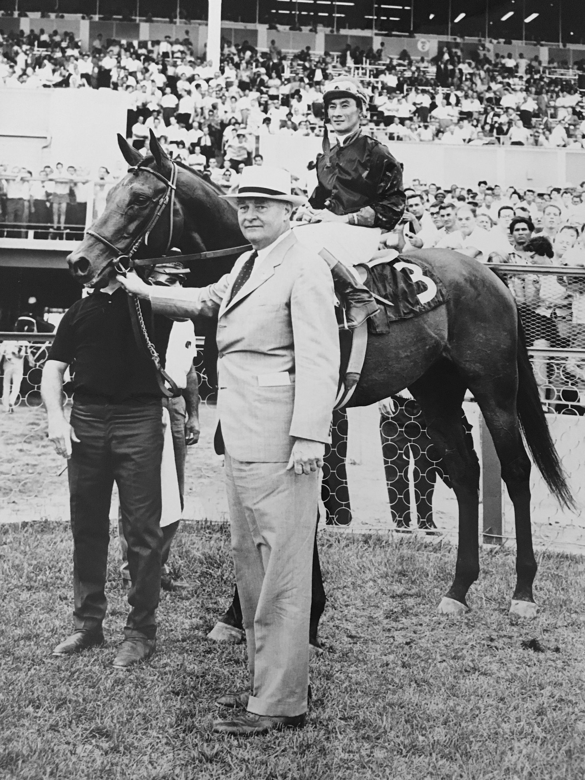 Buckpasser (Braulio Baeza up) and Ogden Phipps (Keeneland Library Thoroughbred Times Collection)