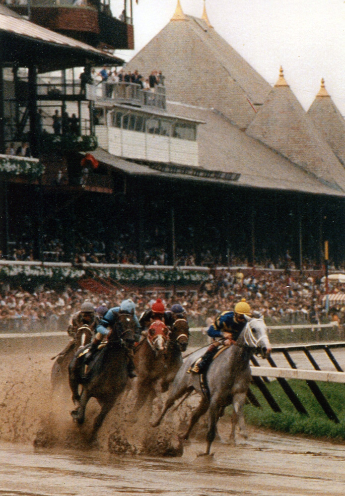 Lady's Secret (Pat Day up) leading at the first turn in the 1986 Whitney at Saratoga (Mike Pender/Museum Collection)