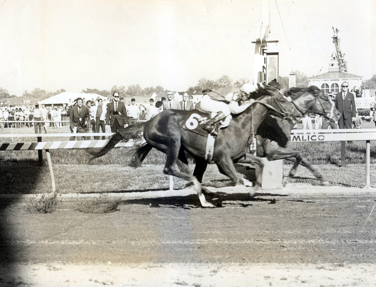 Majestic Prince (Bill Hartack up) defeating fellow future Hall of Famer Arts and Letters (Braulio Baeza up) by a head in the 1969 Preakness (Museum Collection)