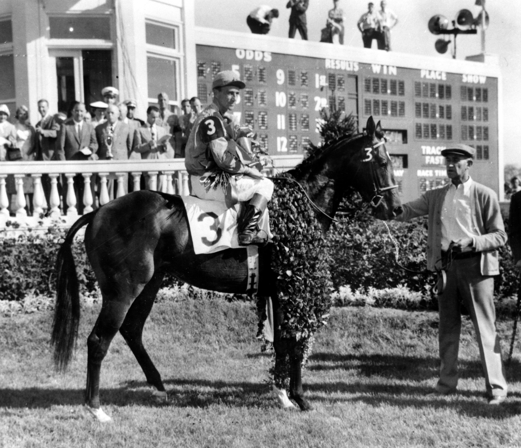 Needles (Dave Erb up) in the winner's circle for the 1956 Kentucky Derby (Keeneland Library Morgan Collection/Museum Collection)