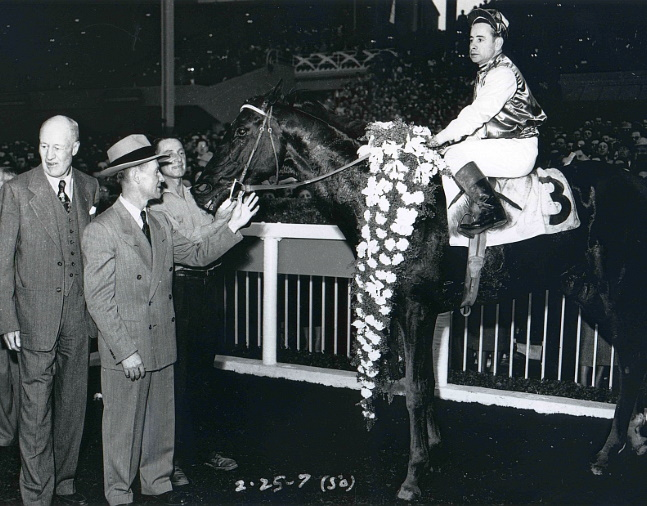 Noor (Johnny Longden up) in the winner's circle for the 1950 Santa Anita Handicap (Bill Mochon/Museum Collection)