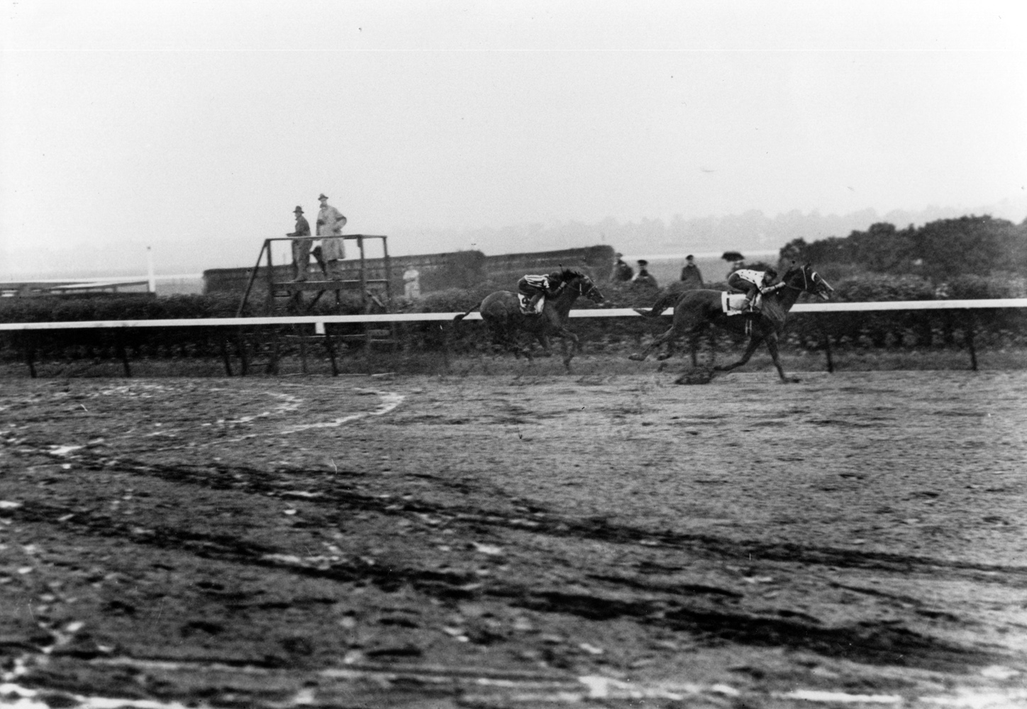 Omaha (Willie Saunders up) winning the 1935 Belmont Stakes and becoming America's third Triple Crown winner (Keeneland Library Cook Collection/Museum Collection)