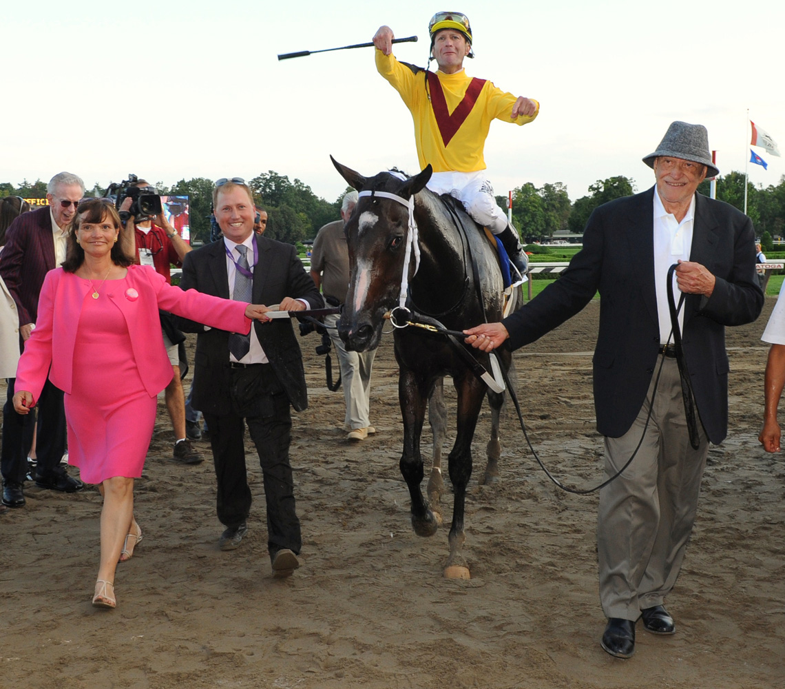 Rachel Alexandra (Calvin Borel up) being led into the winner's circle by owners Barbara Banke and Jess Jackson after winning the Woodward (NYRA)
