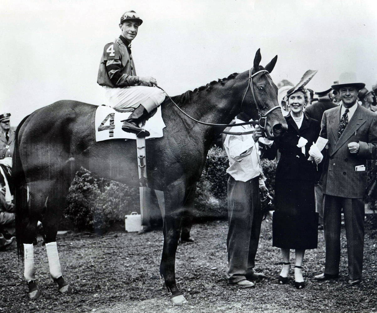 Real Delight (Eddie Arcaro up) in the winner's circle for the 1952 Coaching Club American Oaks (Museum Collection)