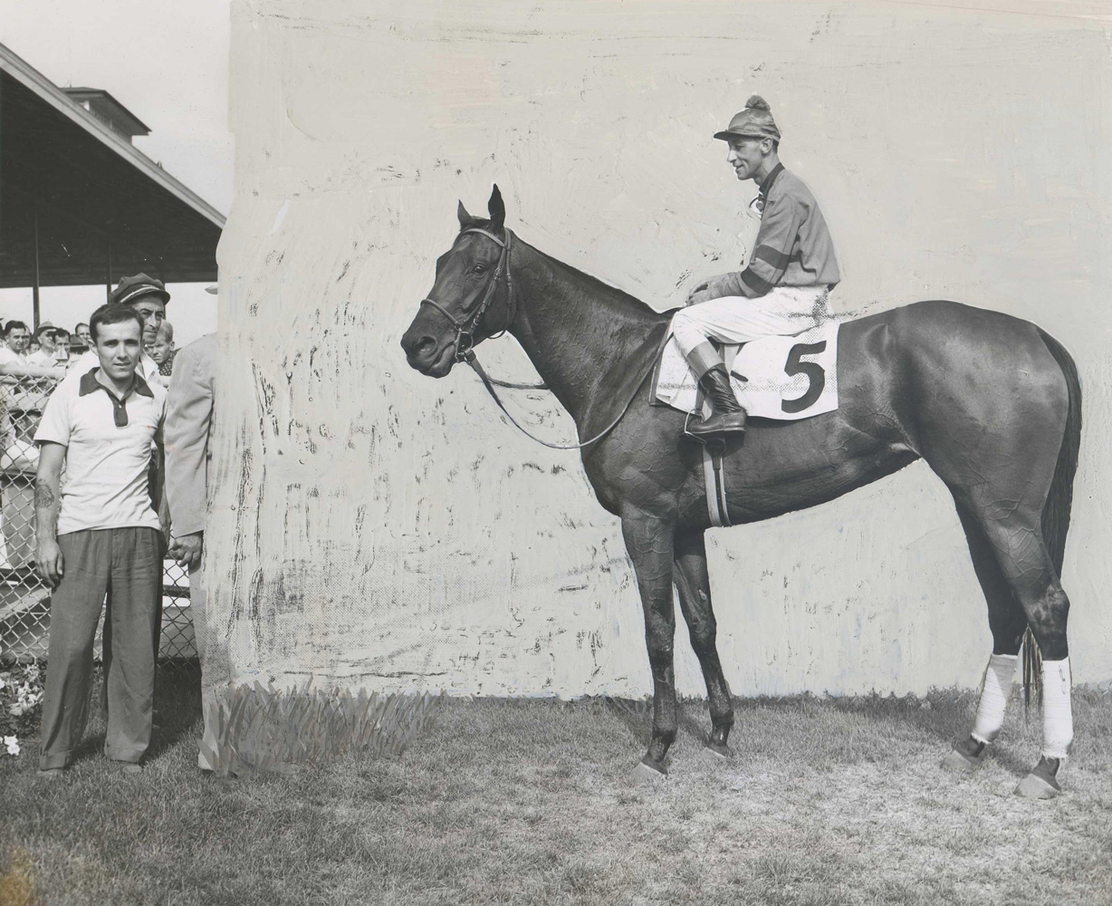 Hand-retouched winner's circle photo of Real Delight (Eddie Arcaro up) for the 1953 Arlington Matron Handicap at Arlington Park (Museum Collection)