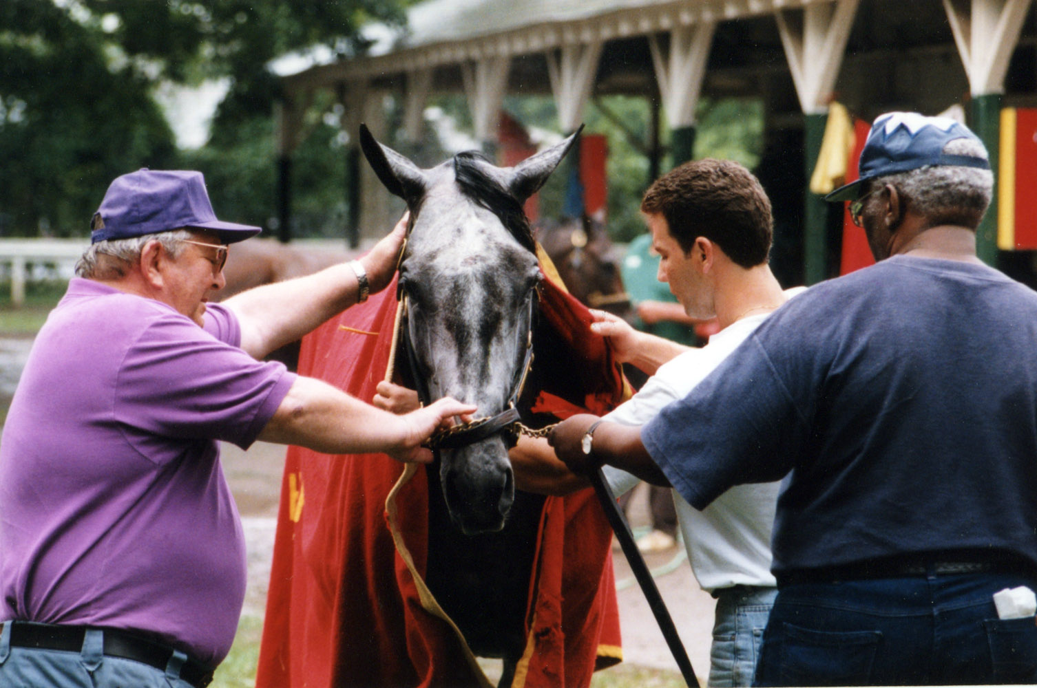 Skip Away with trainer Sonny Hine at Saratoga, 1998 (Mike Pender/Museum Collection)