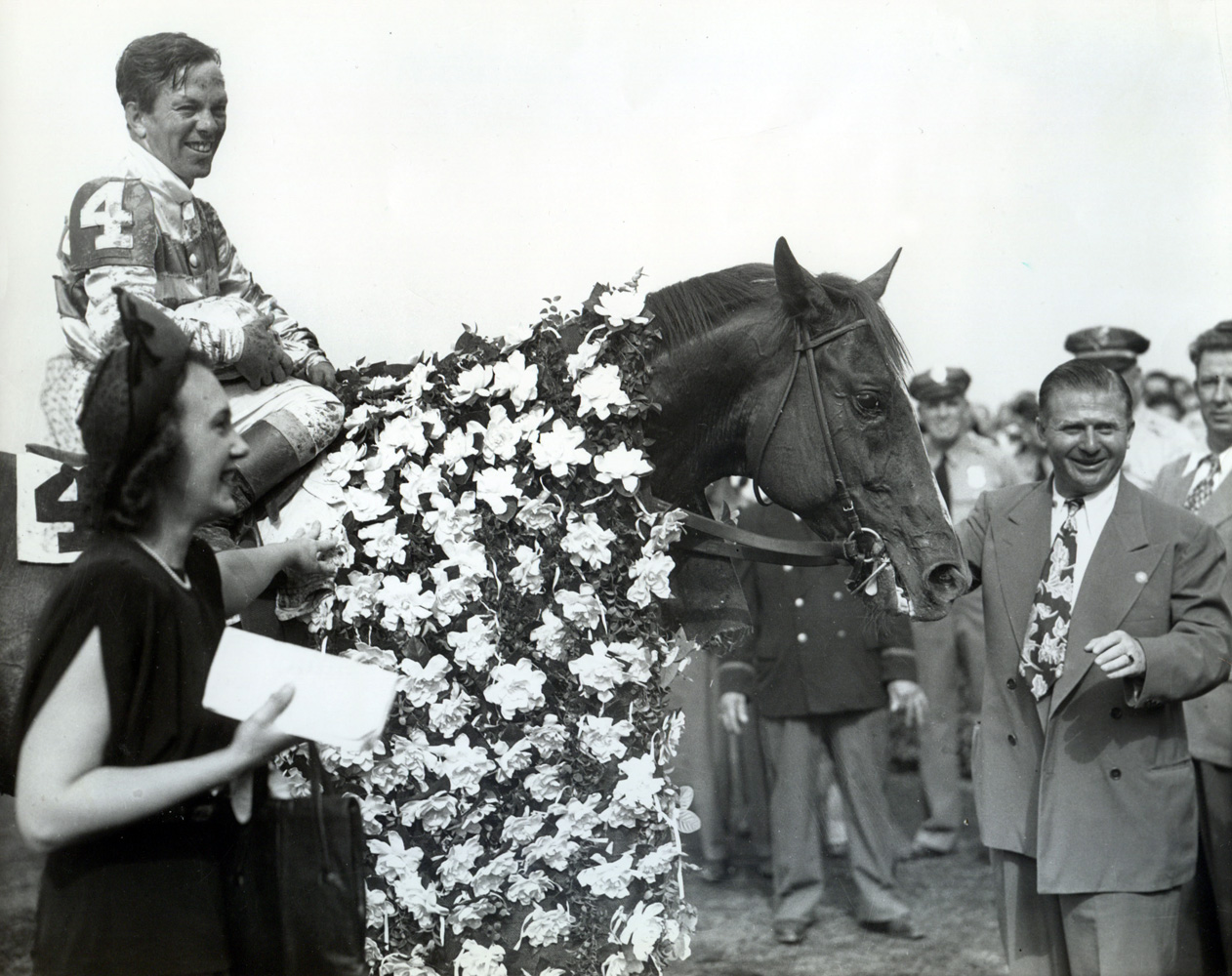Stymie (Conn McCreary up) with owner Ethel D. Jacobs and trainer Hirsch Jacobs after winning the 1947 Empire City Gold Cup at Belmont (Museum Collection)