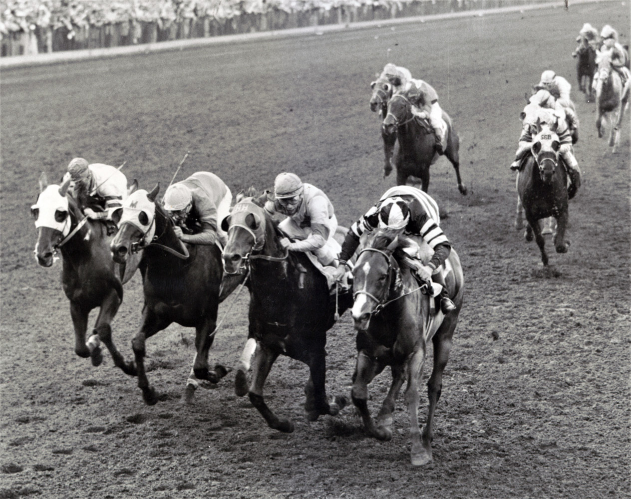 Swoon's Son with Dave Erb up (on the right) winning the 1957 Citation Handicap at Washington Park (Keeneland Library Thoroughbred Times Collection)