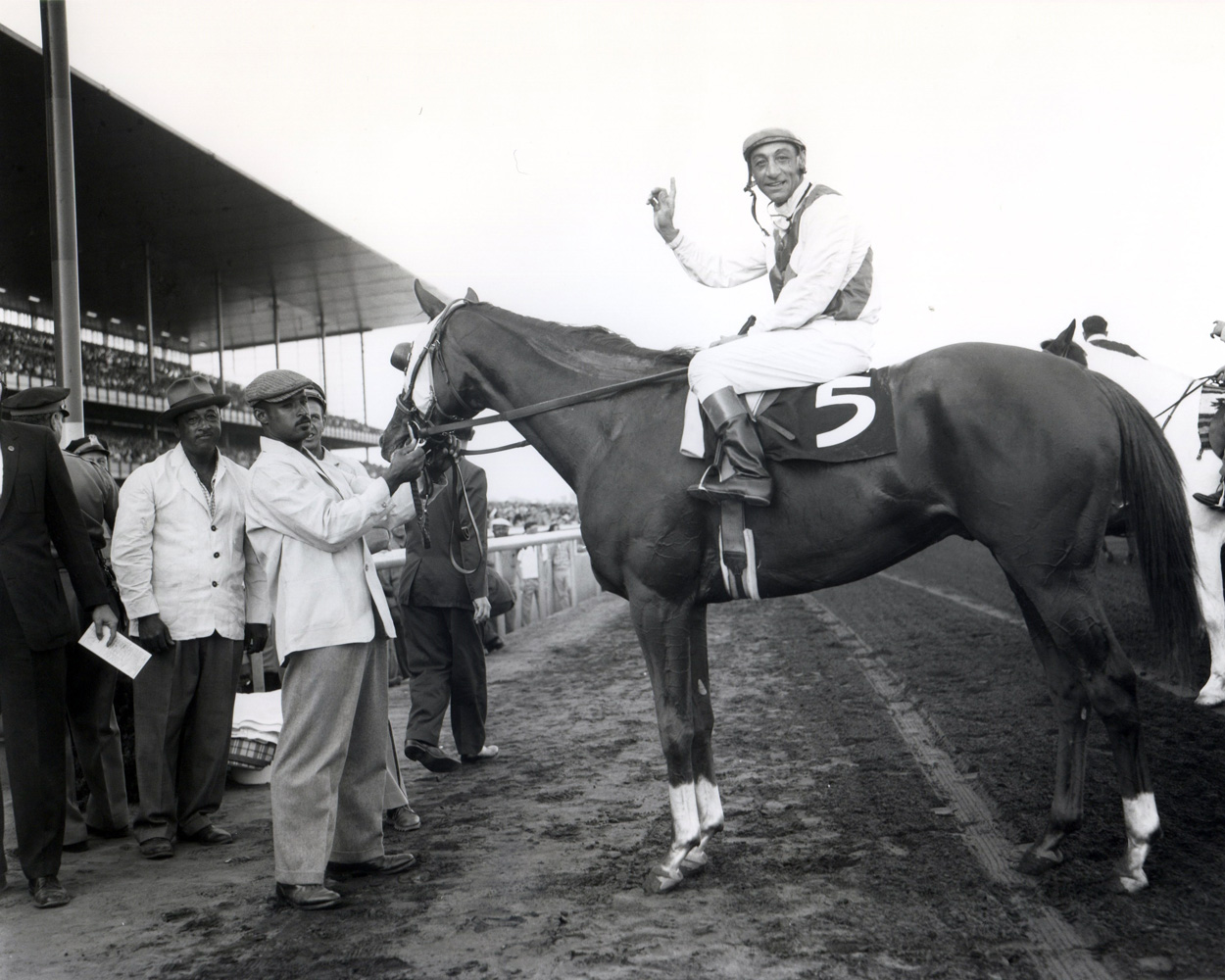 Sword Dancer (Eddie Arcaro up) in the winner's circle for the 1959 Woodward (Keeneland Library Morgan Collection/Museum Collection)
