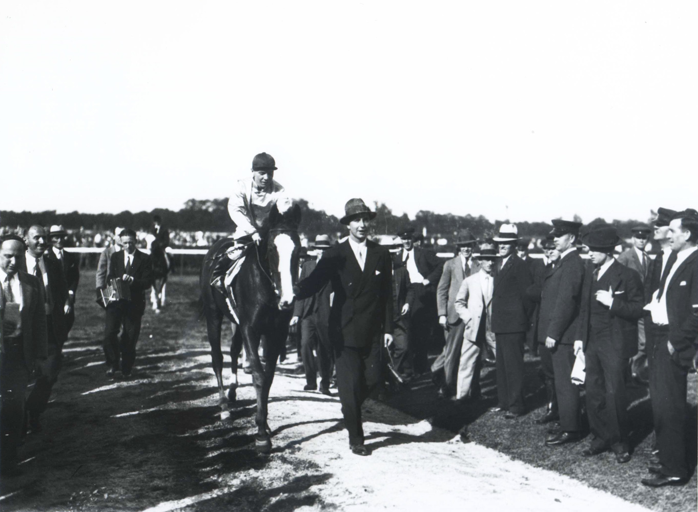 Top Flight (Raymond Workman up) entering the winner's circle with owner C. V. Whitney (Keeneland Library Cook Collection/Museum Collection)