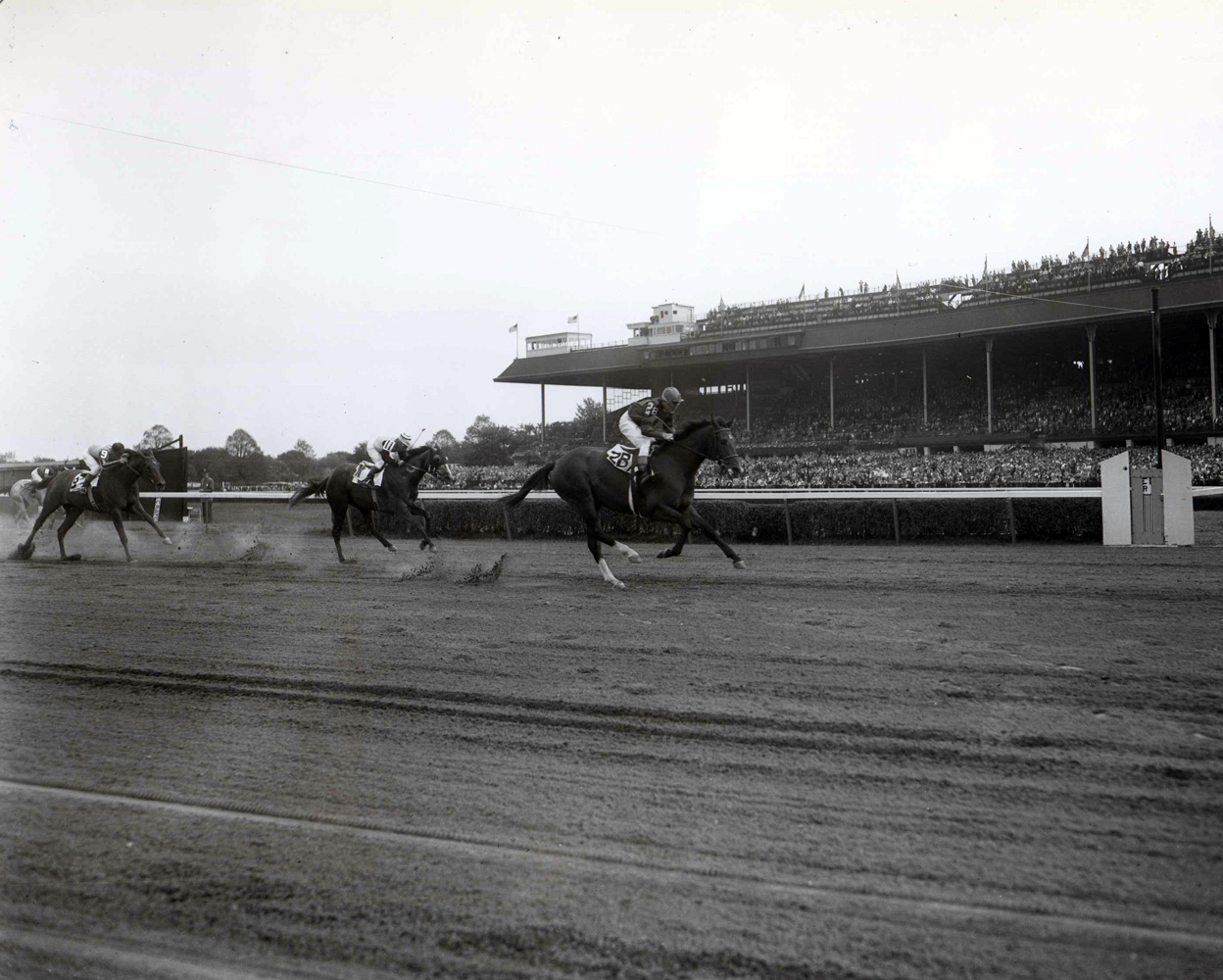 Two Lea (Niebold Pierson up) winning her first career race at Belmont Park, September 1948 (Keeneland Library Morgan Collection/Museum Collection)