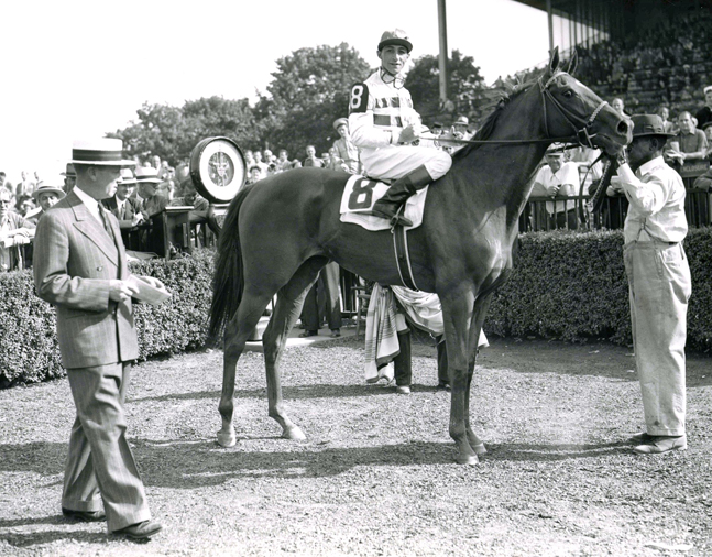 Busher (Eddie Arcaro up) in the winner's circle for 1944 Adirondack at Belmont Park (Keeneland Library Morgan Collection/Museum Collection)