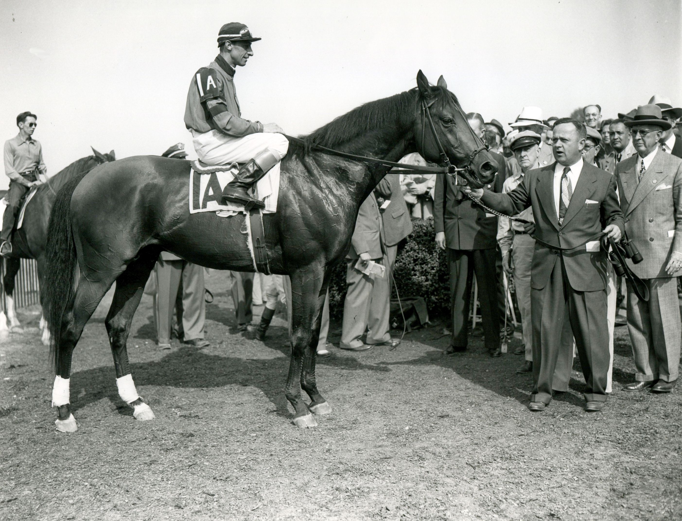 "Citation (Eddie Arcaro up) being held by trainer Horace A. ""Jimmy"" Jones after winning the 1948 Belmont Stakes (Keeneland Library Morgan Collection/Museum Collection)"