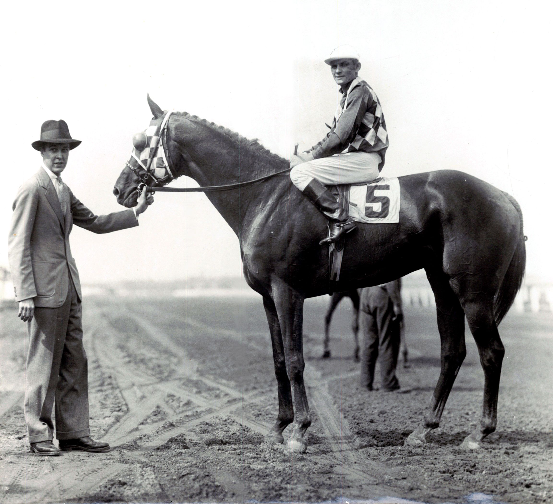 Discovery in the winner's circle at Aqueduct with owner Alfred G. Vanderbilt on June 28, 1934 (C.C. Cook/Museum Collection)