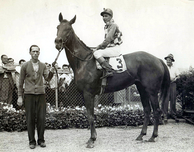 Gallorette with Job D. Jessop up in the winner's circle, undated (Bert Morgan/Museum Collection)