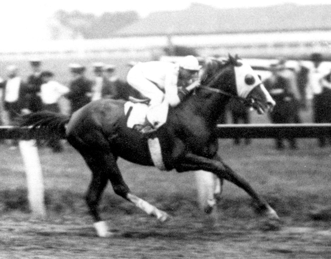 Grey Lag racing to victory with Earl Sande up (Keeneland Library Cook Collection/Museum Collection)