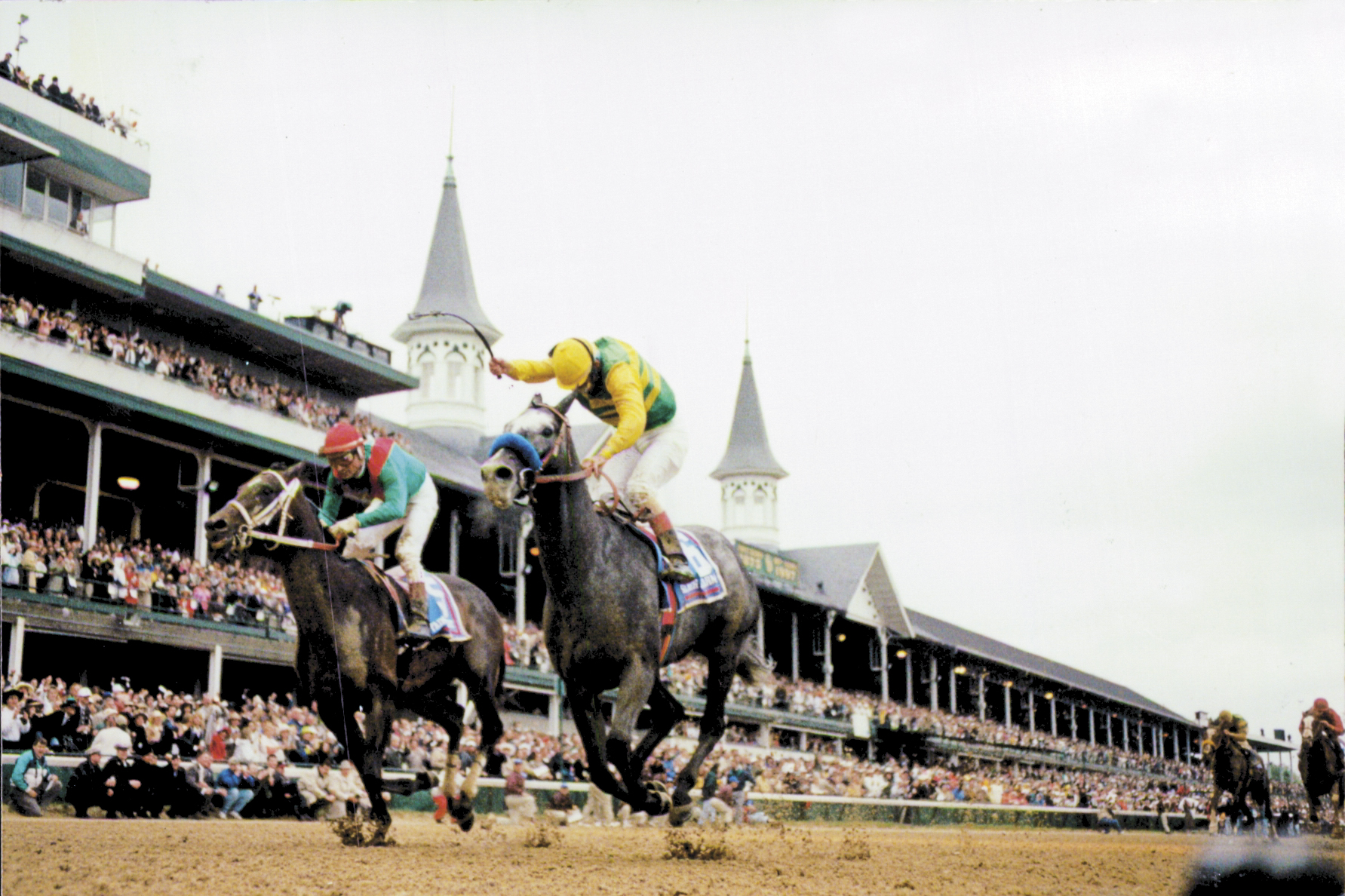 Silver Charm (Gary Stevens up) charging down the stretch to win the 1997 Kentucky Derby by a head (Skip Dickstein)