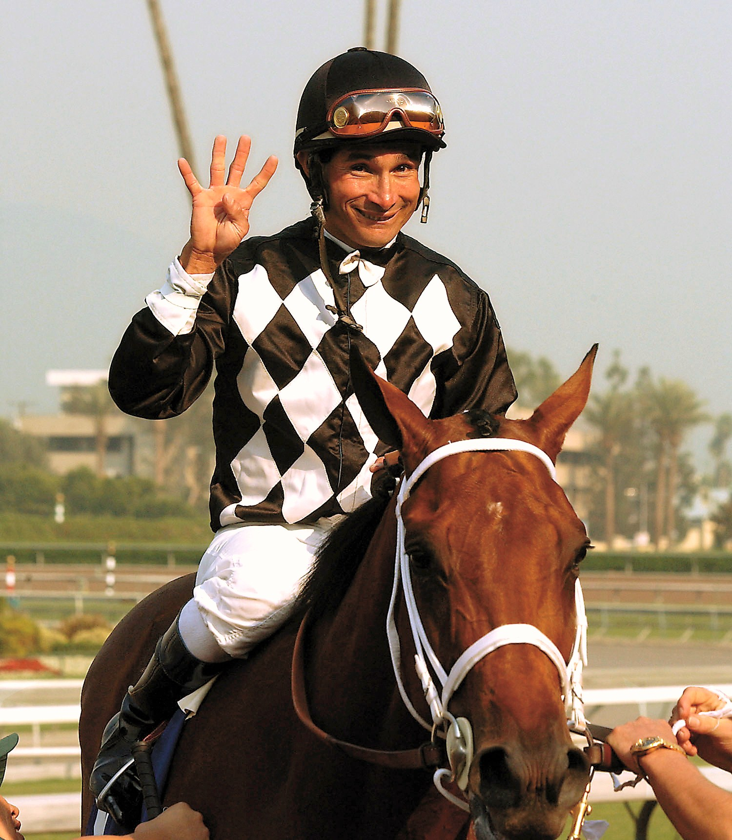 Alex Solis celebrates his 4,000th career victory in 2003 at Santa Anita (Anne Ebenhardt)