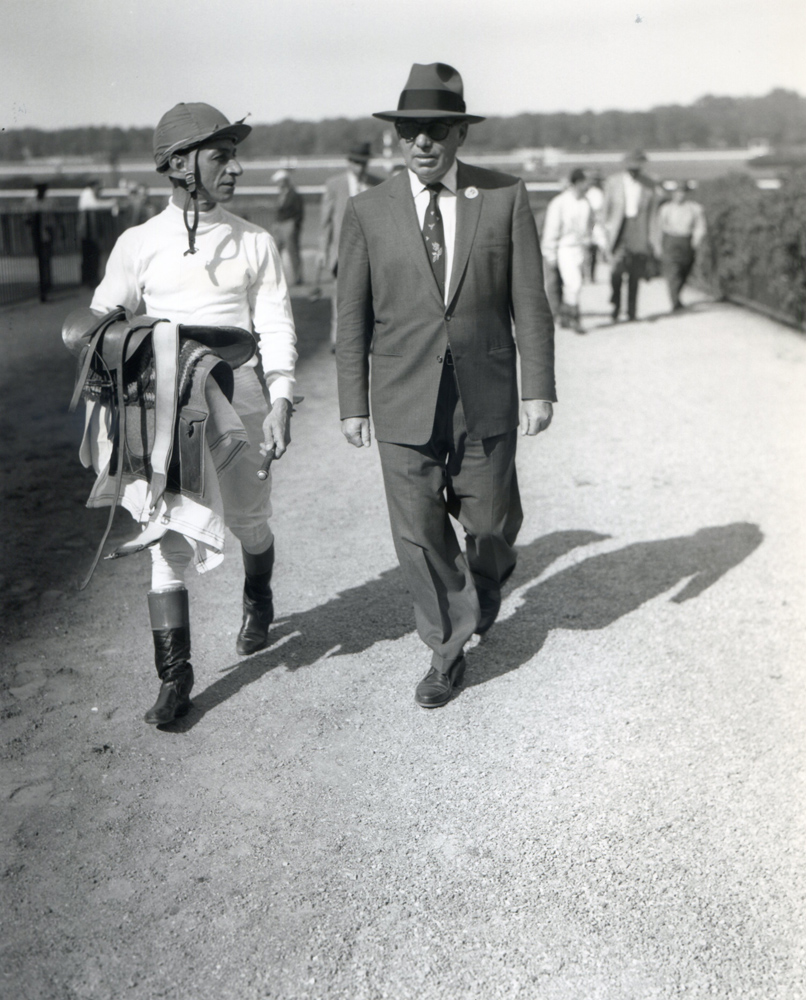 Eddie Arcaro and trainer William Molter at Belmont Park, 1958 (Keeneland Library Morgan Collection/Museum Collection)
