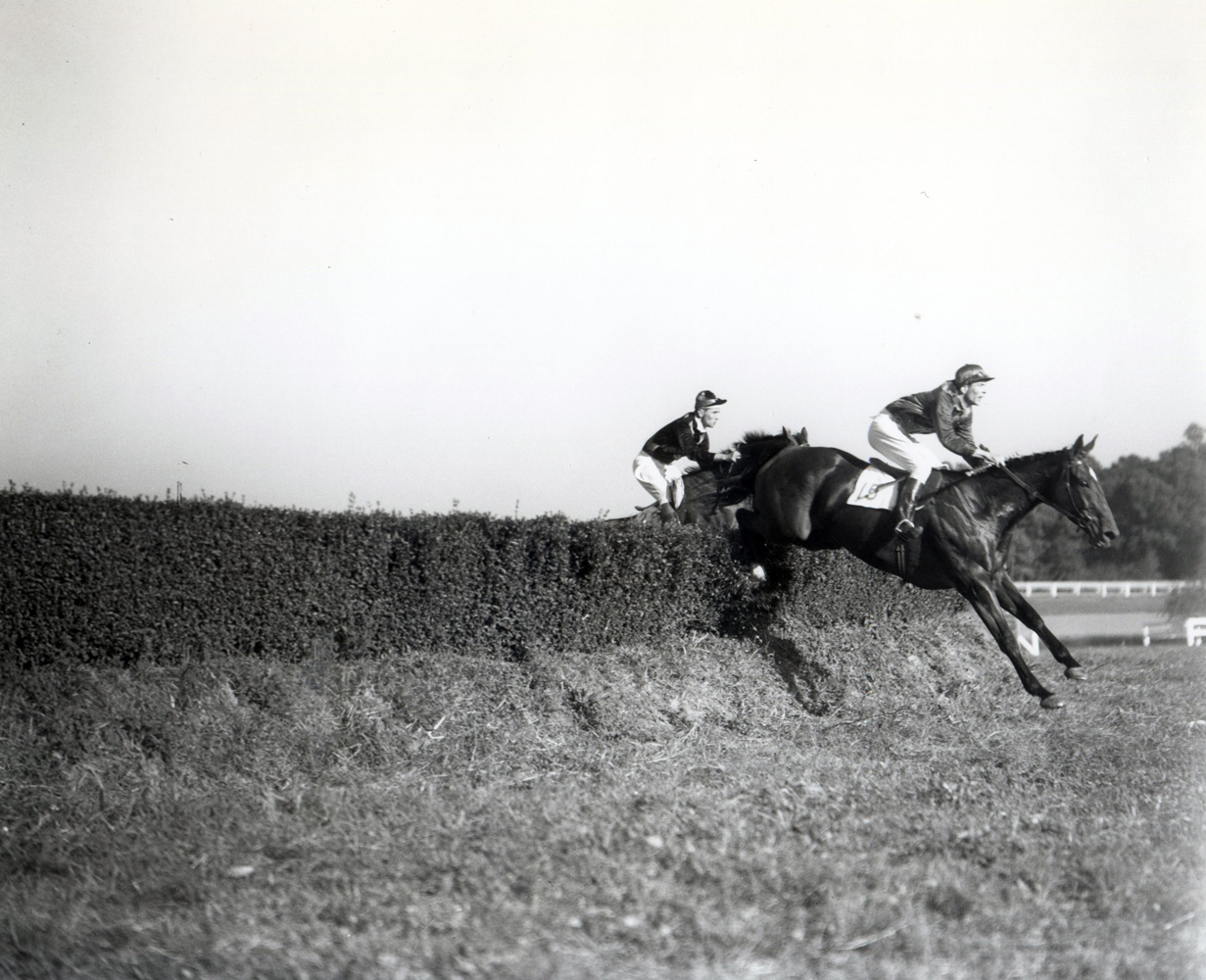 Carroll Bassett and Passive competing in the King Oak Steeplechase at the Huntington Valley Hunt Races (Keeneland Library Morgan Collection/Museum Collection)