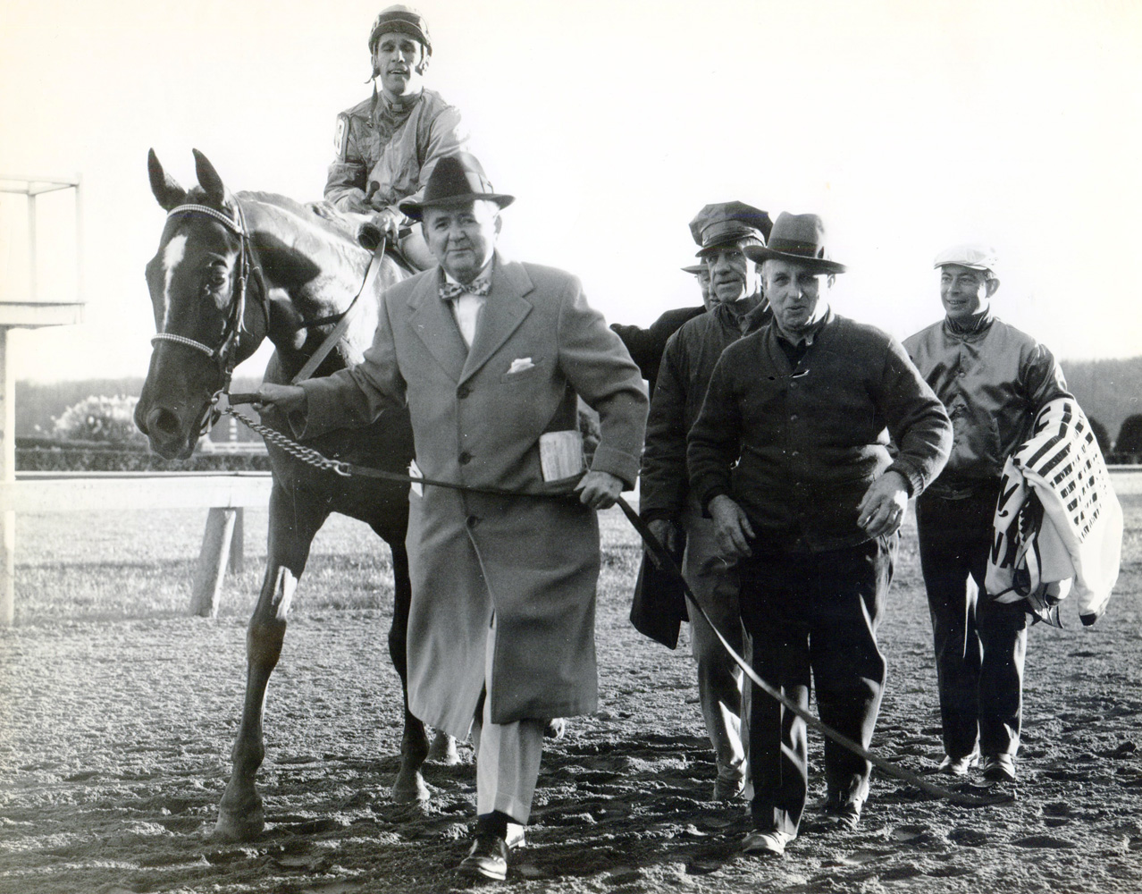 Sam Boulmetis and Mahan enter the winner's circle after winning the 1957 Washington D.C., International at Laurel (Museum Collection)