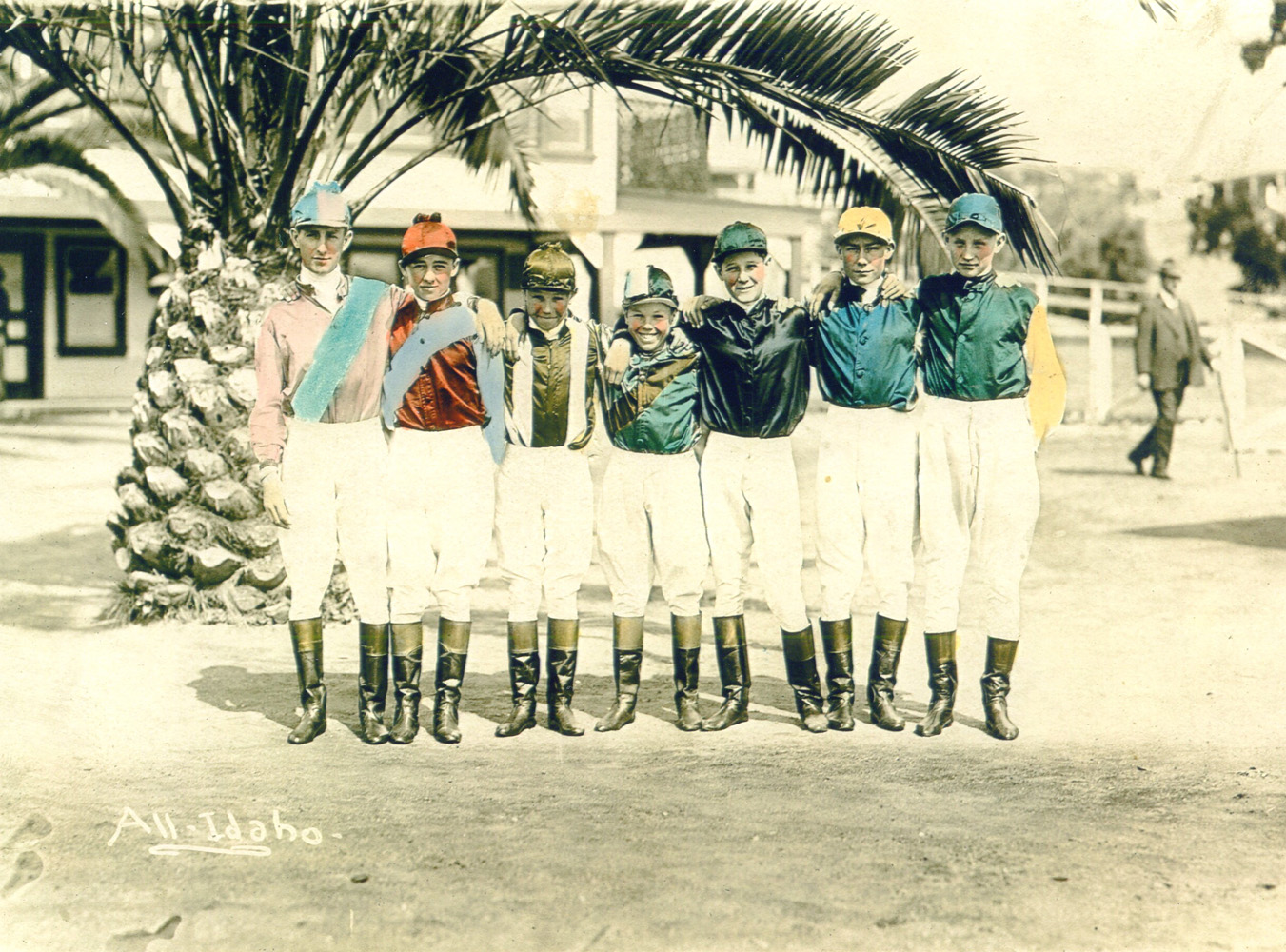 Colorized photograph of a jockey colony featuring Laverne Fator, Mark Fator, Art Mortensen, G. Dick Johnson, Ivan Parke, and two unidentified riders (from left to right) (Museum Collection)